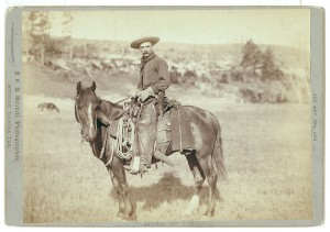 vintage sepia photo of a cowboy on a horse